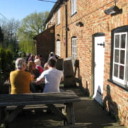 Picnic tables to the front of the pub and a large well kept beer garden to the rear