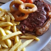 8oz Sirloin steak, served with fries, tomato & onion rings