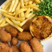 SCAMPI & CHIPS served with garden peas and tartare sauce